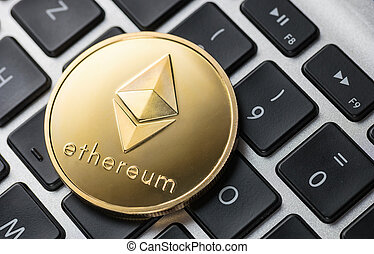 Golden ethereum coin on notebook