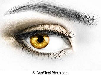 B&W photo of a right woman's eye with colored golden eyeball