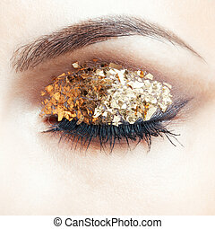 Golden eye makeup - Close-up shot of female face with vogue ...