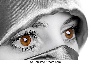 Abstract image of a woman wearing a headscarf which has been digitally enhamced to highlight her eyes, this is the natural colour of the models eyes.