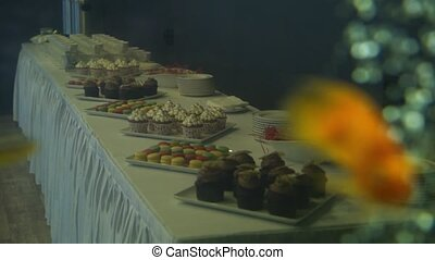 Golden fish in a freshwater aquarium, cupcakes and desserts...