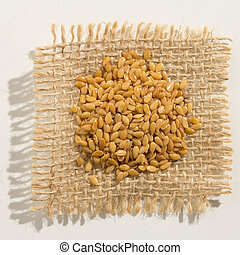 Golden Flax Seed. Close up of grains over burlap.