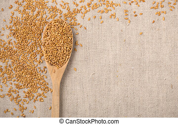 Golden flaxseed background, top view