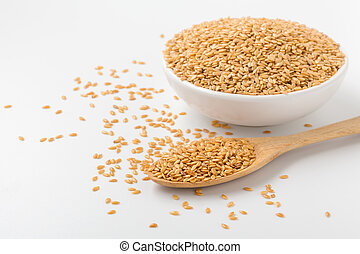 Golden flaxseed background with space