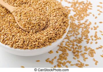 Golden flaxseed in bowl, closed up