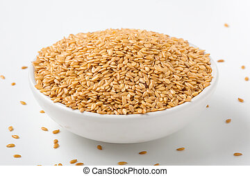 Golden flaxseed in white bowl
