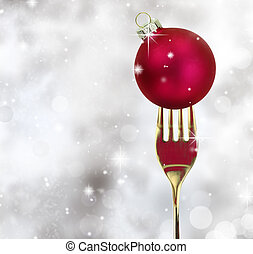 Golden fork with Christmas ball in a glittery background