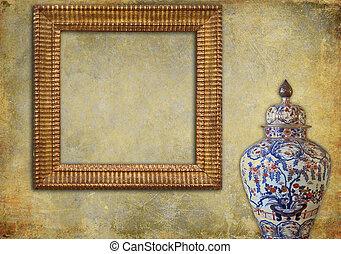 Golden frame and ancient oriental vase on a grunge background