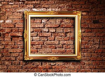 Golden frame on brick wall