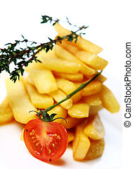 Golden french fries served with tomato