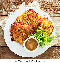 Golden fried potato fritters with mustard