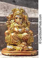 Golden ganecha statue