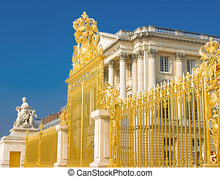 Golden gate and Palace facade in Versailles over blue sky. ...