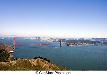 Golden gate bridge from the Marin headlands, with sail boats...