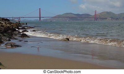 Golden Gate Bridge in San Francisco, California. Sandy beach...