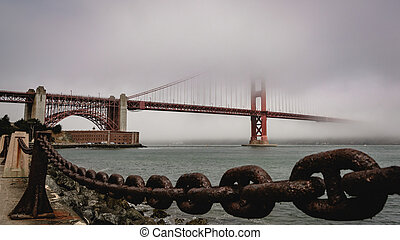 Golden Gate Bridge in the Fog With Fort Point in the Distance