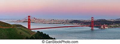 Golden Gate Bridge panorama at sunset in San Francisco as...