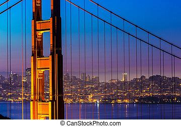Golden Gate Bridge San Francisco sunset through cables - ...