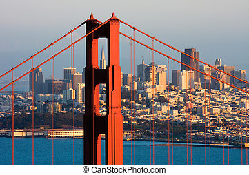Golden Gate Bridge and downtown San Francisco at sunset