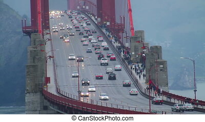 Vehicle and pedestrian traffic on the world famous Golden Gate Bridge in San Francisco, California. Shot from the San Francisco side of the bridge looking North.
