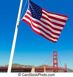 Golden Gate Bridge with United States flag San Francisco - ...