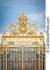 Golden gate of Chateau de Versailles. Paris, France, Europe....