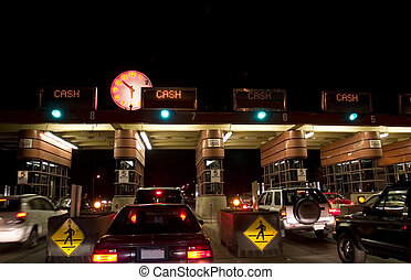 Golden Gate toll road at night with  cars waiting to pay