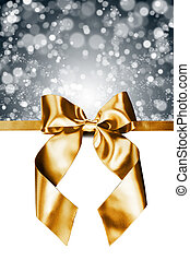 Golden gift bow on white
