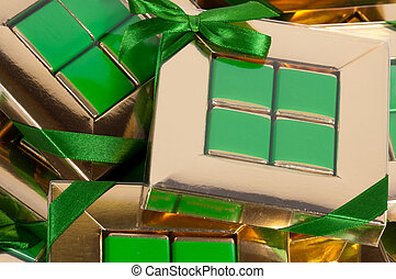 golden gift box with a green bow