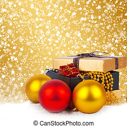 Golden gift box with Christmas balls and garlands of beautiful beads on abstract  background