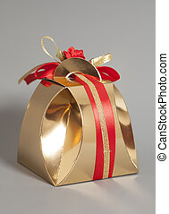 Golden gift box with ribbon