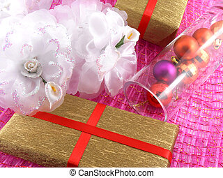 Golden gift box with white flowers and christmas balls in glass