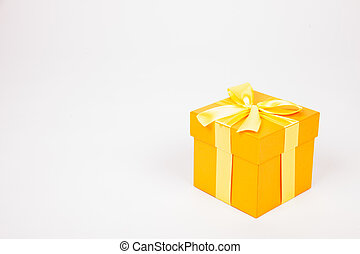 Golden gift box with yellow ribbon isolated on white background