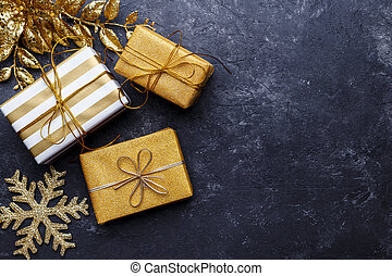 Golden gift boxes and Christmas decorations