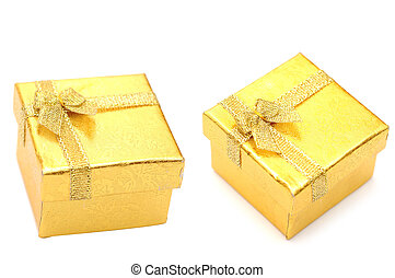 Golden gift boxes with golden ribbon