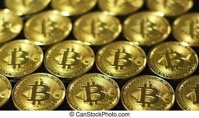 Golden glimmering bitcoins in arrangement - Close-up view of...