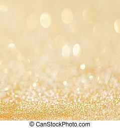 Golden glitter christmas abstract background with bokeh defocused golden lights