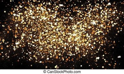Golden glitter dust on black background. Sparkling splash...