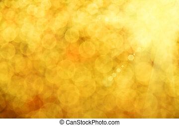 Golden glitter light summer abstract blur background