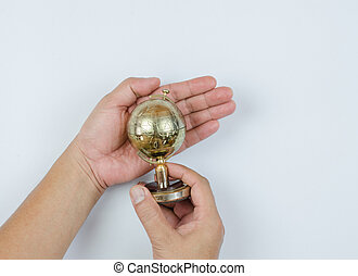 Golden Globe in hand isolated on white background