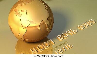 Golden globe on golden credit card