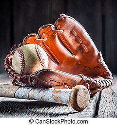 Golden glove and old baseball ball