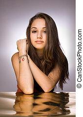 Golden glow. - Artistic portrait of beautiful young brunette...