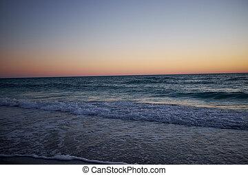 Golden glow sunset over a calm Florida ocean