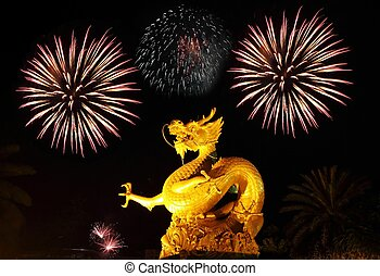 Golden gragon statue with fireworks, Phuket Thailand