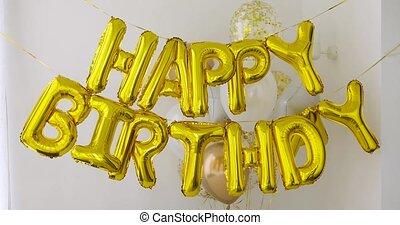 Golden HAPPY BIRTHDAY words made of balloons - Golden HAPPY...