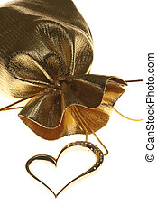 Golden heart shaped necklace on white background