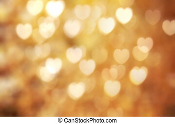 Golden heart symbol bokeh