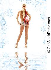golden heels girl in bikini on white sand