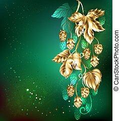 Golden hops on a green background